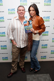 Elvis Duran's khakis and striped button-down were a handsome pairing for, um, work.