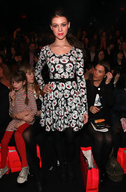 Nicola Peltz attended the Betsey Johnson fashion show wearing--what else--a Betsey Johnson Marilyn Monroe-print dress.