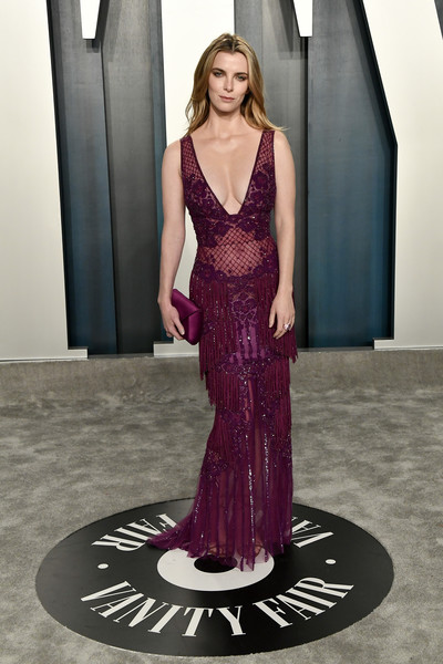 Betty Gilpin Fringed Dress [oscar party,vanity fair,clothing,dress,gown,purple,fashion model,fashion,formal wear,haute couture,pink,shoulder,beverly hills,california,wallis annenberg center for the performing arts,radhika jones - arrivals,radhika jones,betty gilpin]