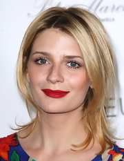 Mischa Barton looked all too classy while attending the Beverly Hills Fashion Festival. She gave her natural look some pop with bold red lips.