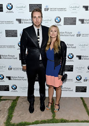 Dax Shepard stood out at the Beverly Hills Hotel anniversary celebration in his iridescent black suit.