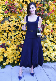 Camilla Belle looked refined in a navy midi dress by Ralph Lauren at the Golden Globe Awards menu unveiling.