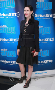 Jill Kargman teamed a fitted blazer with a strappy leather dress for the anniversary of Andy Cohen's SiriusXM channel.