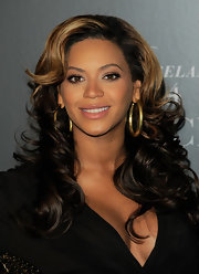 Beyonce wore a creamy nude lipstick with lots of shine while hosting a screening of 'Live of Roseland.'