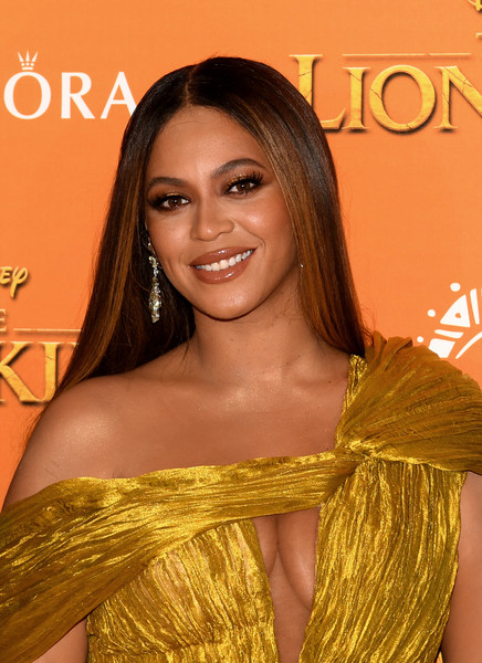 Beyonce Knowles-Carter Long Straight Cut [the lion king,hair,hairstyle,long hair,beauty,eyebrow,hair coloring,shoulder,amber,brown hair,smile,beyonce knowles-carter,european,england,london,odeon luxe leicester square,disney,premiere]