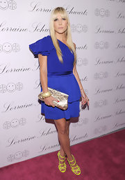 Tinsley looks stunning in this one shoulder royal blue cocktail dress. The starlet matched this bright look with neon Jimmy Choo shoes and red polish.