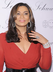 Tina Knowles flashed her orange manicure which was filed into an elegant round shape.