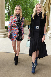 Laura Whitmore kept it fun and vibrant in a mixed-print wrap dress at the 'Beyond the Road' exhibition opening.