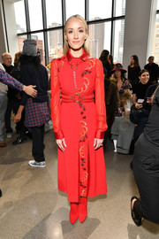 Nastia Liukin was impeccably dressed in a red Bibhu Mohapatra frock with sheer sleeves and metallic embroidery down the front during the label's Fall 2018 show.