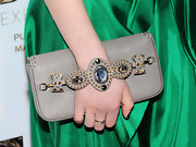 Sami Gayle's clutch seemed to act as a piece of jewelry with its gem-inlaid strap.