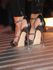 Shiny metallic strappy sandals add some serious height for Davina McCall.