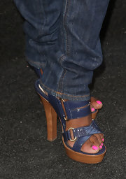 Tichina Arnold was casual yet stylish in jeans and blue platform sandals at the Get Schooled Initiative launch.