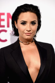 Demi Lovato worked an edgy slicked-back bob during Billboard's Women in Music event.