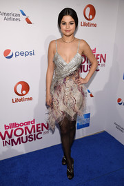 Selena Gomez got into a Roaring Twenties mood with this beaded and feathered Rodarte dress for Billboard's Women in Music event.