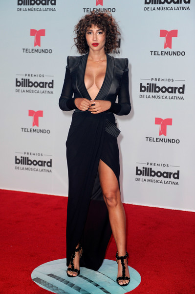Jackie Cruz complemented her sizzling-hot dress with a pair of black T-strap sandals by Alaia.