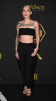 A pair of black Yousef Akbar pants with fringed sides completed Skylar Grey's look.