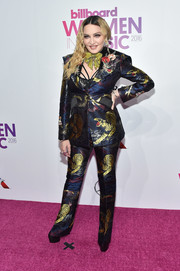Madonna hit the Billboard Women in Music 2016 rocking a tiger-print jacquard pantsuit by Gucci.