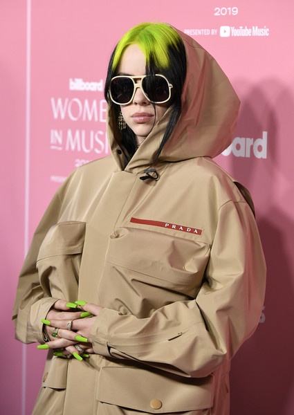Billie Eilish Bright Nail Polish [billboard women in music,song,eyewear,pink,clothing,outerwear,yellow,glasses,trench coat,fashion,personal protective equipment,cool,outerwear,billie eilish,2019 billboard women in music,guy,arrivals,eyewear,pink,clothing,song,bad guy,bad guy,grammy awards,selenators,billboard women in music,billie eilish]