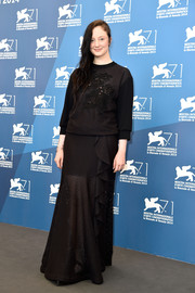 Andrea Riseborough matched her top with a long black ruffle skirt.