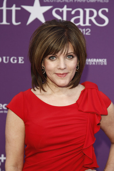 Birgit Schrowange Medium Layered Cut [hair,hairstyle,bangs,layered hair,brown hair,hair coloring,long hair,premiere,bob cut,feathered hair,duftstars awards,duftstars awards,tempodrom,berlin,germany,birgit schrowange]
