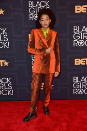 Amandla Stenberg went for a funky menswear-inspired vibe in this burnt-orange pantsuit and chartreuse shirt combo (all by Moschino) at the Black Girls Rock! show.