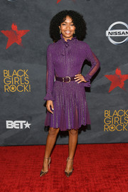 Yara Shahidi polished off her look with gold ankle-strap pumps by Jimmy Choo.
