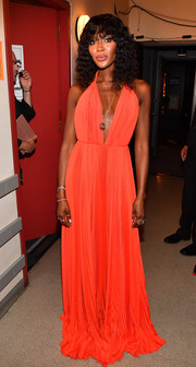 Naomi Campbell looked divine in a plunging orange halter gown by Calvin Klein at the 2018 Black Girls Rock! event.