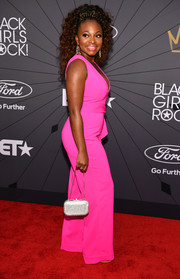 Naturi Naughton arrived for the 2018 Black Girls Rock! event carrying a sparkling silver purse by Judith Leiber.