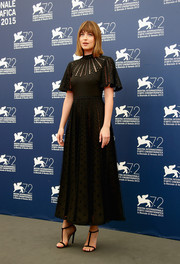 Dakota Johnson worked a Victorian-meets-goth vibe in this high-neck Valentino LBD during the 'Black Mass' photocall.