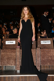 Amber Heard went for timeless glamour at the 'Black Mass' premiere in a figure-hugging black Stella McCartney gown featuring a plunging sweetheart neckline and a flowing train.