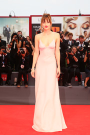 Dakota Johnson donned a simple yet very sexy backless pink gown by Prada for the premiere of 'Black Mass.'