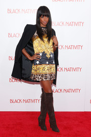 Keenyah Hill finished off her ensemble in fierce style with a pair of knee-high brown suede boots.