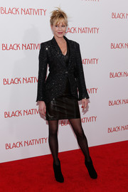 Melanie Griffith was edgy-glam at the 'Black Nativity' premiere in a beaded black jacket layered over a leather dress.