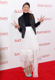 Zendaya Coleman finished off her ensemble with a pair of turquoise Christian Louboutin So Kate pumps for a pop of color.