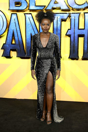 Lupita Nyong'o looked downright fab in an intricately beaded, high-slit gown by Balmain at the European premiere of 'Black Panther.'