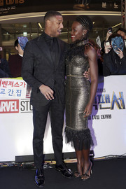 Lupita Nyong'o complemented her gorgeous frock with a pair of bejeweled sandals by Olgana Paris.