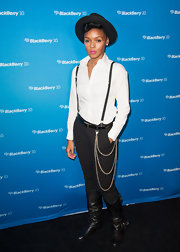 Janelle Monae chose black skinny pants to top off her tailored tomboy look.