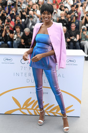 Damaris Lewis topped off her bright outfit with a pink blazer.