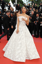 Nicole Scherzinger brought some bridal glamour to the Cannes red carpet with this strapless white ball gown by Ashi Studio Couture.