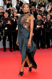 Naomi Campbell turned heads in a Poiret dress with a mesh bodice and a draped teal overlay at the Cannes Film Festival screening of 'BlacKkKlansman.'