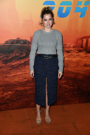 Ana de Armas paired her sweater with a beaded navy pencil skirt with a high front slit, (also by Chanel).