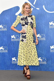 Naomi Watts oozed summertime charm in a yellow, navy, and white floral frock by Roksanda at the Venice Film Festival photocall for 'The Bleeder.'