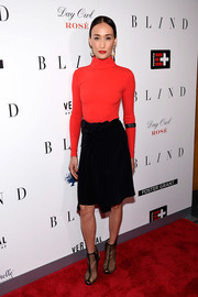 Maggie Q completed her fall-inspired look with a black velvet skirt.