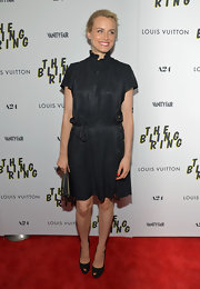 Taylor Schilling wore a black high-collar dress with a belted waist for 'The Bling Ring' screening.