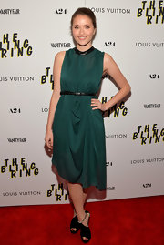 Katie Chang rocked deep emerald draped dress with a leather neckline and matching belt.
