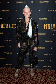 Maye Musk completed her head-turning attire with gold cross-strap pumps by Christian Louboutin.