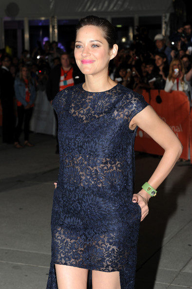 Marion Cotillard's embellished green cuff provided a lovely color contrast to her navy lace dress at the 'Blood Ties' premiere.