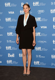 Marion Cotillard wrapped up in a kimono-like Dior dress with a pastel blue neckline for the 'Blood Ties' press conference during the 2013 Toronto International Film Festival.