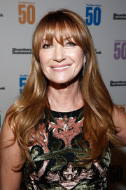 Jane Seymour wore her hair down in flippy waves with eye-skimming bangs at the Bloomberg 50 celebration.