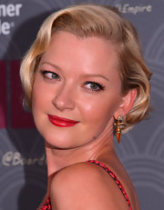 Gretchen Mol dressed up her look with a pair of dangling gold and diamond earrings when she attended the 'Boardwalk Empire' season four premiere.